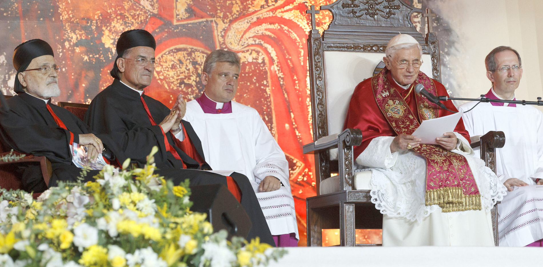 Pope Benedict XVI delivers his talk during a meeting with young people outside the Maronite patriarch's residence in Bkerke, Lebanon, Sept. 15. At left are Cardinal Nasrallah P. Sfeir and Maronite Catholic Patriarch Bechara Rai. (CNS photo/Paul Haring) (Sept. 15, 2012) See LEBANON-YOUTH Sept. 15, 2012.