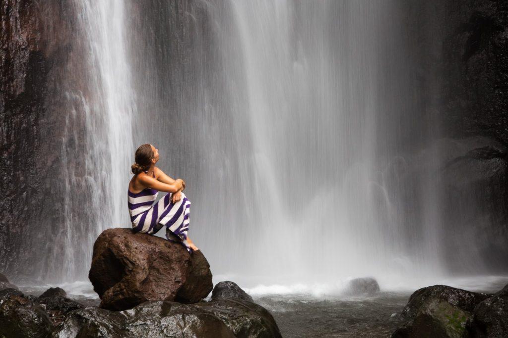 waterfall w woman on rock