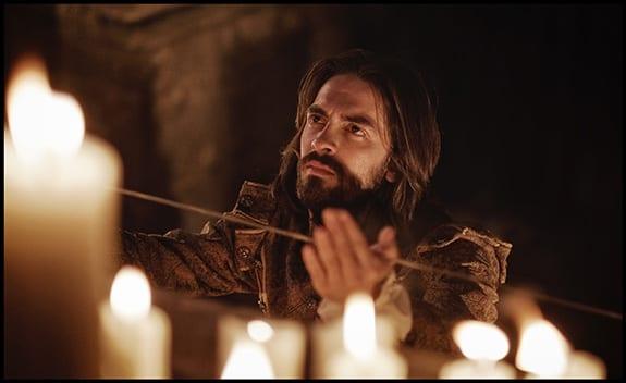 ignatius of loyola movie candles man holding
