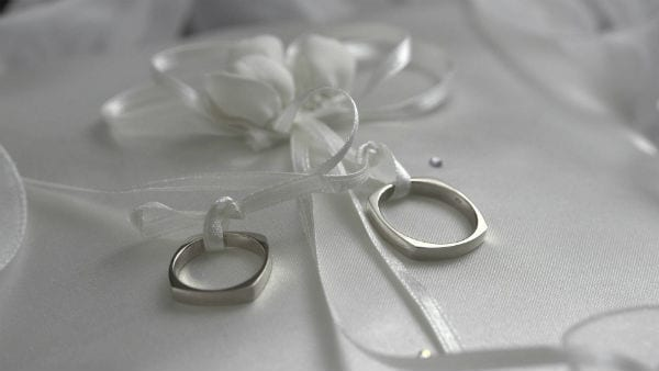 ring rings pillow tied white