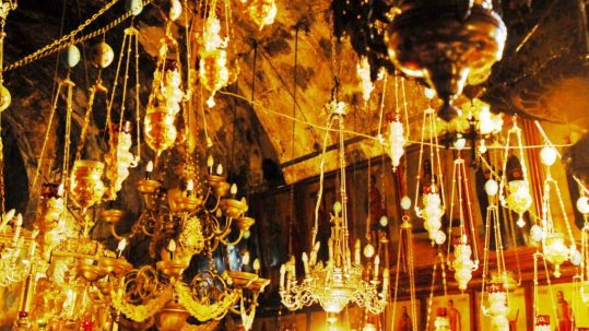 Via Dolorosa Tomb of Mary G candles chandeliers lights cave indoors inside