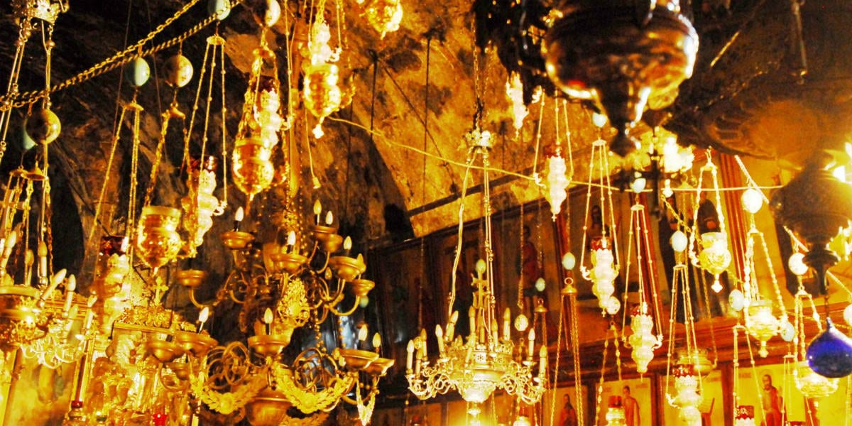 Via Dolorosa Tomb of Mary G candles chandeliers lights cave indoors inside via dolorosa good friday holy week land pilgrimage