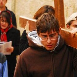 Via Dolorosa carrying a cross holyland