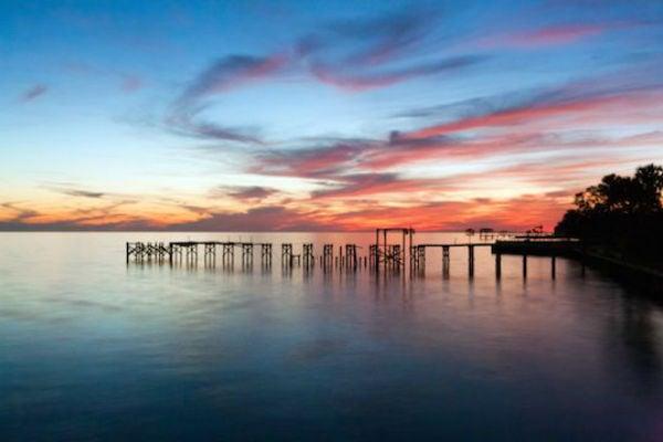 sunset dock on ocean new orleans