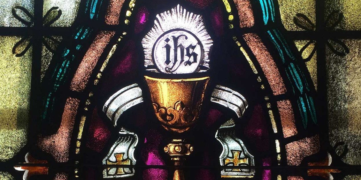 ambrose eucharist sacrament body blood flesh words consecration transubstantiatiion real presence