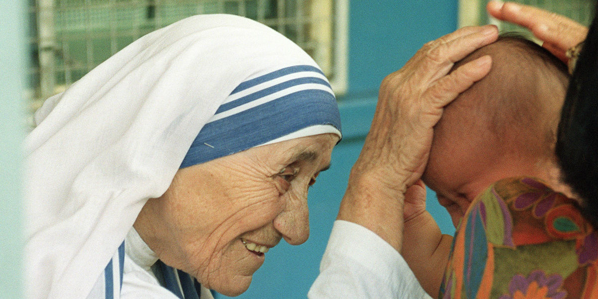 mother teresa blessing a baby facebook