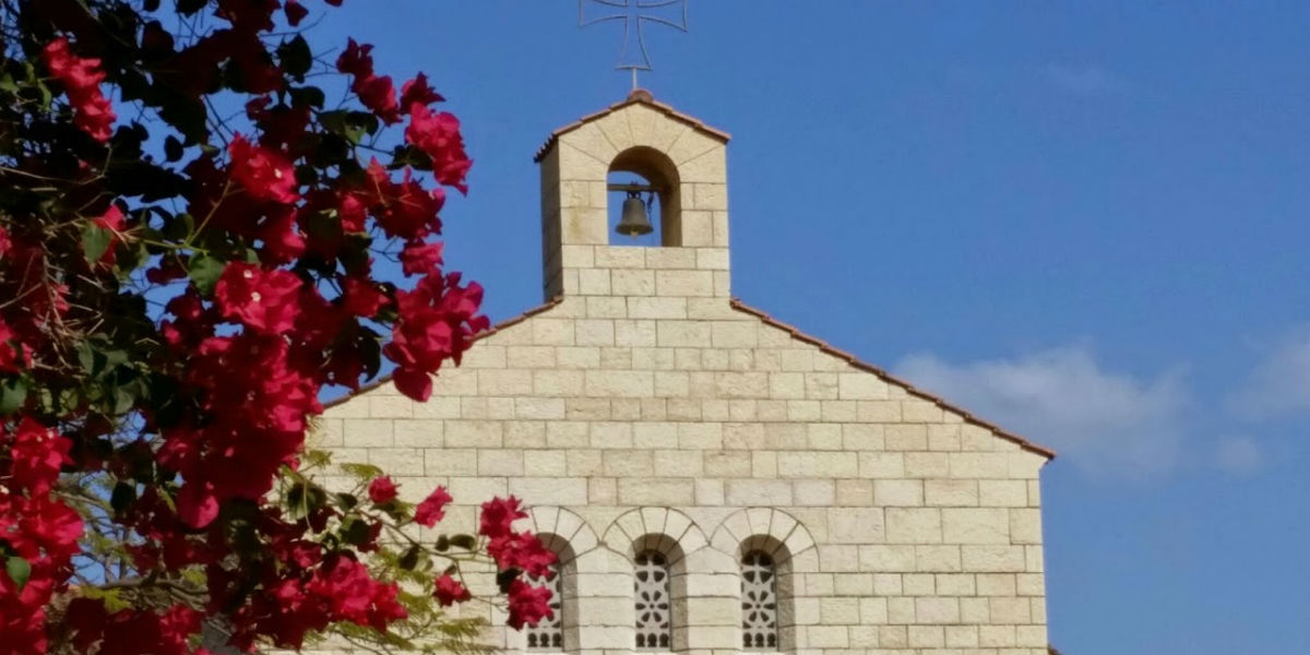top of church with flowers Tabga heptageon loaves fish