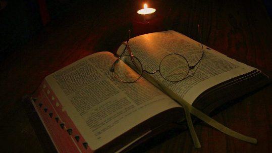 candle light reading the bible Sias van Schalkwyk