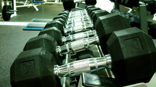 weights in a gym building spiritual muscle