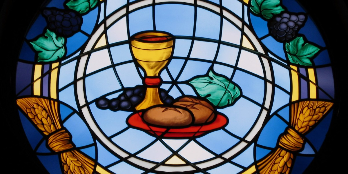 aquinas thomas - on th eucharist stained glass chalice wine bread