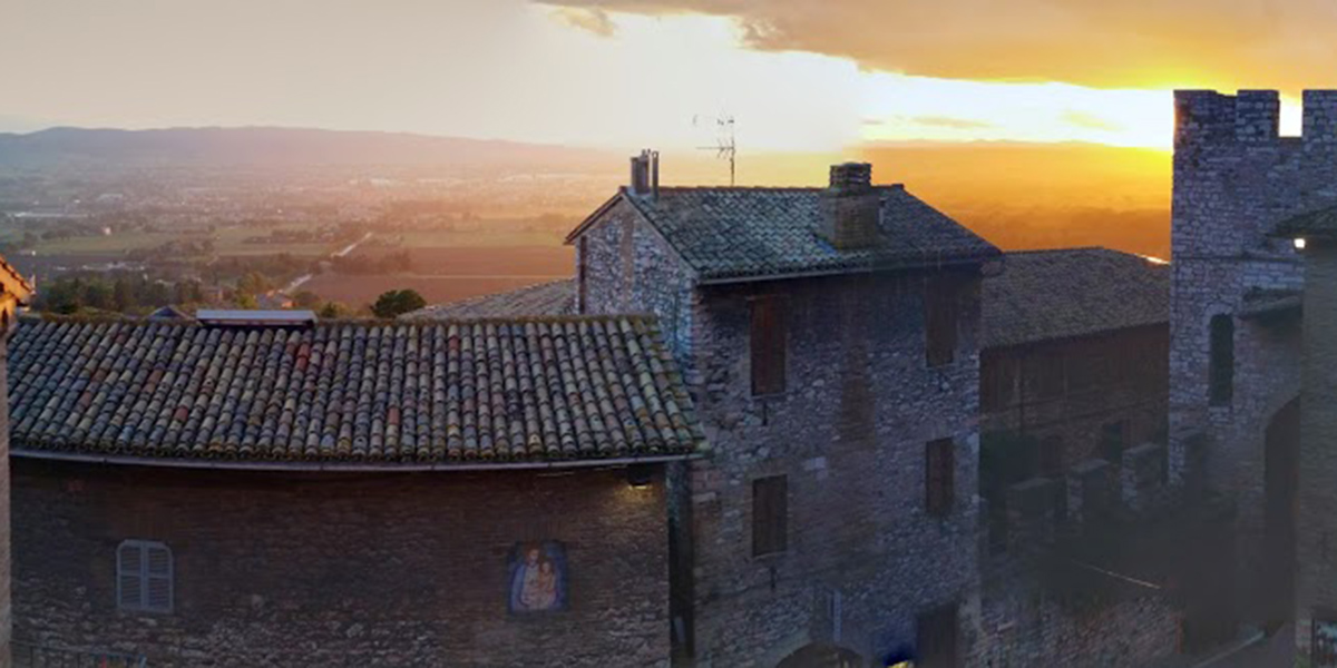 Saint Francis of Assisi sunset rooftops magical medieval town